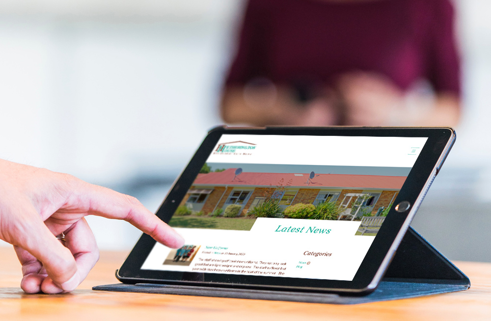 Responsive, Tauranga digital design agency. Client project  - Hetherington House, Website design & development, web hosting, graphic design, website latest news page on tablet