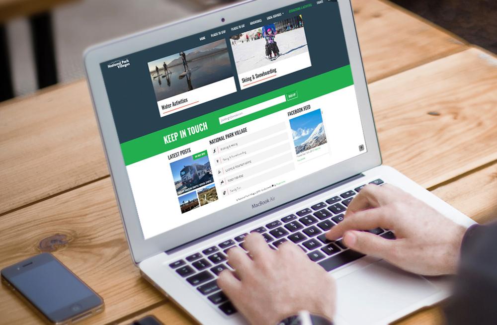 Responsive, Tauranga digital design agency. Client project  - National Park Villages, Website design & development, Web hosting, website footer on laptop